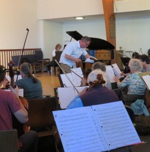 Photo of Paul Colthorpe conducting and Elvera Penner accompnying